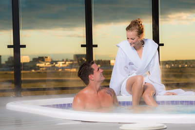 Couple in hot tub in a calgary hotel